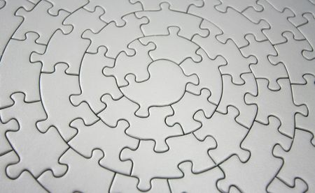 three-dimensional grey jigsaw - wide angle, shallow DOF, focus is on the piece in the center Stock Photo - 1807590