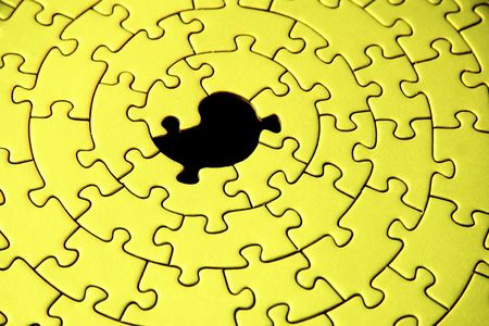 abstract of a yellow jigsaw with one missing piece - focus is on the hole -  Stock Photo - 1807767