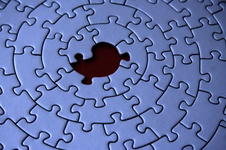 blue jigsaw with one missing piece - focus is on the hole -  photo