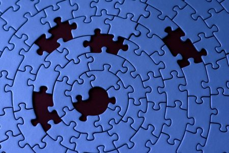 jigsaw in blue with five missing pieces - focus is on the center Stock Photo - 1807628