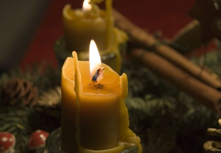 coziness: beeswax candles on an advent wreath - romantic lighting -  Stock Photo