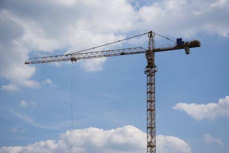 an erection: Erection Crane against a blue sky