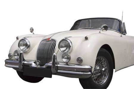 Vintage Jaguar - Convertible - a vision in white in front of a wall