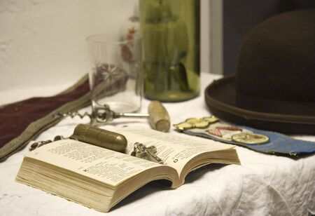 ponderous: vintage still life with an open book and a crucifix - shallow DOF