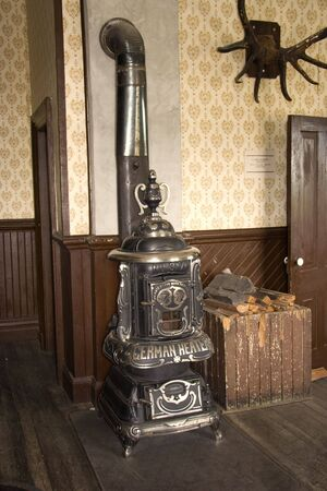 stove pipe: german heater in a vintage hotel room - built 1910