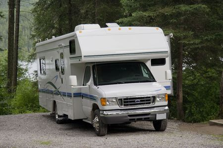 campsite: motorhome with slide-out - on a campground in the whiteswan lake provincial park, british columbia, canada -