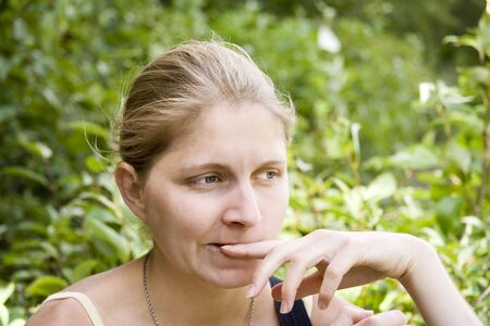young woman engrossed in thought - portrait outdoors -