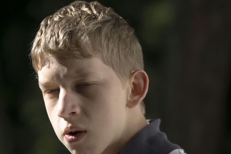 bad temper: teenager in a bad temper - outdoors