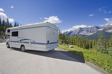 campsite: motorhome side view and wide angle - parked in the rockies, canada -