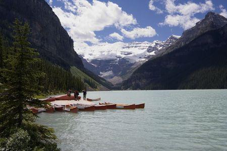 tarn: lake louise with canoe rental - banff national park, canada - Stock Photo