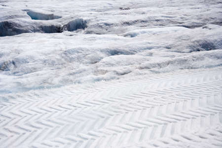 tire tracks in the snow - columbia icefield, jasper national park, canada - photo
