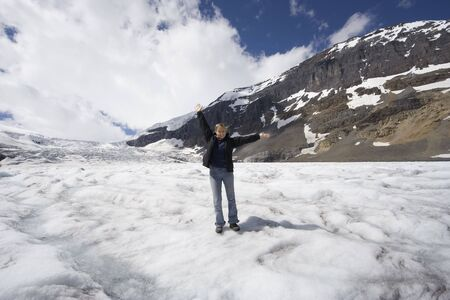 young woman in the snow - athabasca glacier, jasper national park, canada -  photo