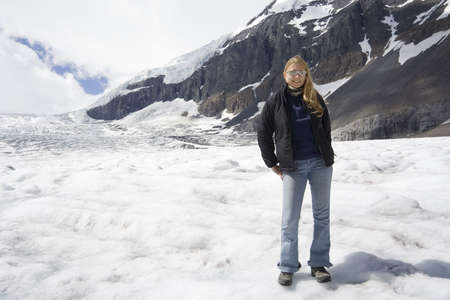 blond woman in the rockies - athabasca glacier, jasper national park, canada -  photo