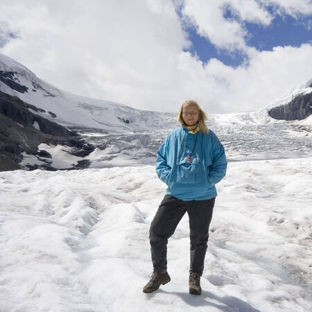 mature woman in the snow - athabasca glacier, jasper national park, canada -  photo