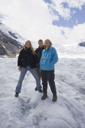 family in the snow - athabasca glacier, jasper national park, canada -  photo
