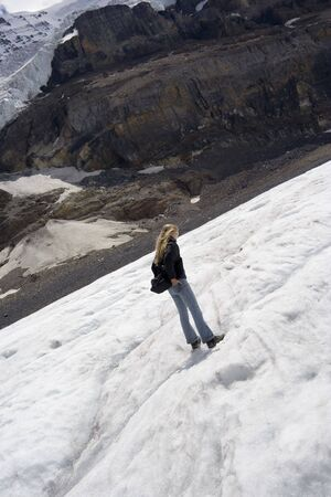 young woman walking on a glacier -  columbia icefield, jasper national park, canada  -   photo
