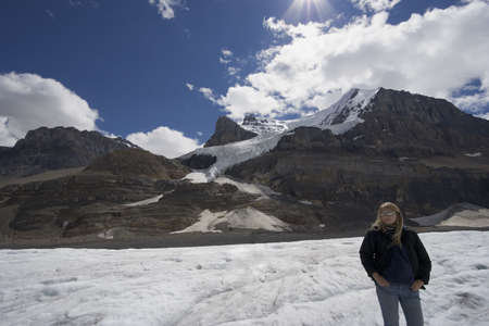 columbia icefield with blond woman - athabasca glacier, jasper national park, canada - photo