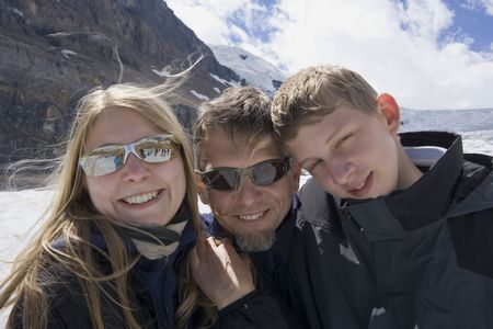 father and kids in the snow - athabasca glacier, jasper national park, canada -  Stock Photo