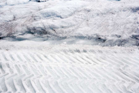 tire tracks in the snow - columbia icefield, jasper national park, canada  photo