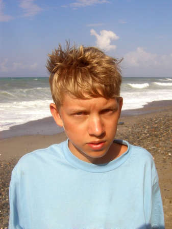 bronzy: Blonde Boy at the beach on a windy day