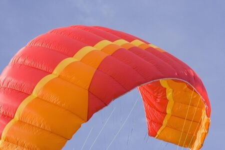 snowkiting: red power kite - this kite is a de-power foil and can be used for buggying, land-boarding or snowkiting -  Stock Photo