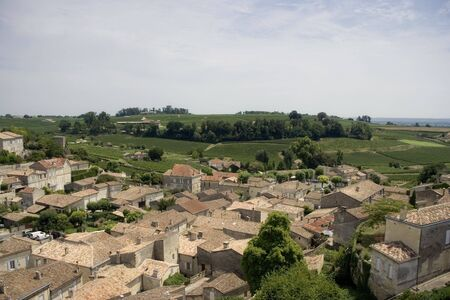 viniculture: view over saint-emilion and vineyards - famous french village -