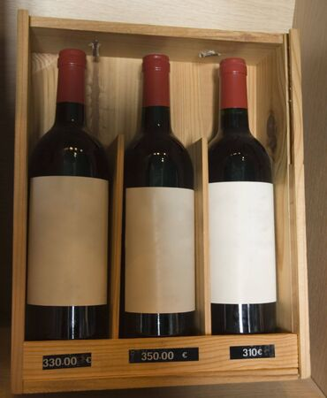 three famous wines in a store - saint-emilion, france -  photo