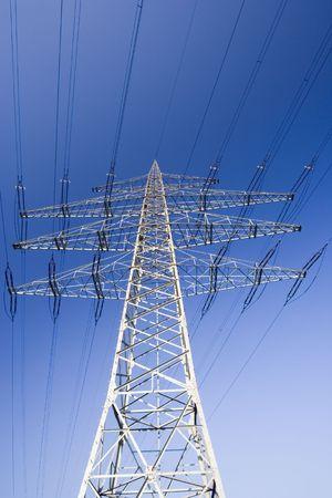solitary electricity pylon - against a blue sky -  photo