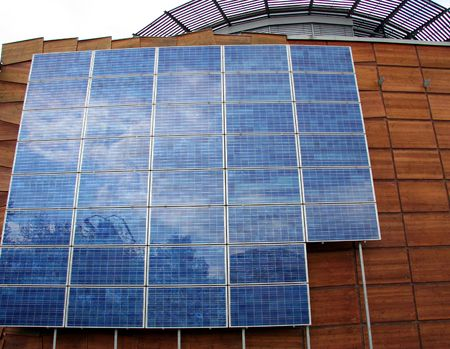 environmentalism: Business Building with Solar Panels - Closeup