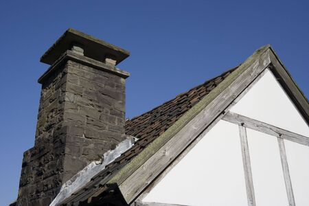 workhouse: roof of an ancient house of poor people - against a deep blue sky
