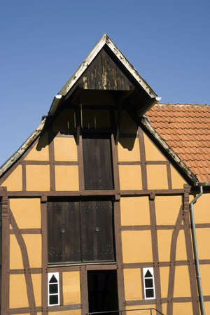 half-timbered house with colored paint - in a traditional german village