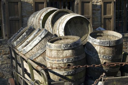 brewery: antique beer barrels - draft beer on a hay cart in front of the brewery