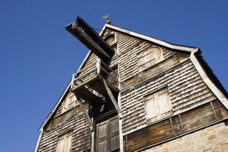 brewage: top of an ancient brewery with wooden shingles - against a blue sky
