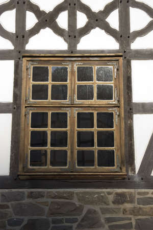 Window of an ancient timbered house - with bulls eye pan