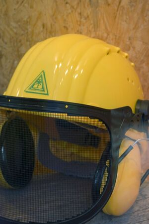 induced: yellow hardhat - employment protection against noise induced hearing loss Stock Photo