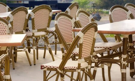 pavement cafe - welcome - tables and cane chairs photo
