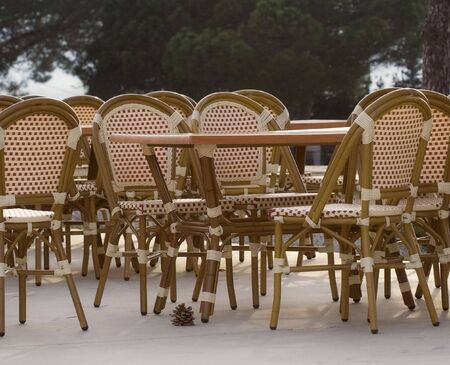 pavement cafe - tables and cane chairs photo