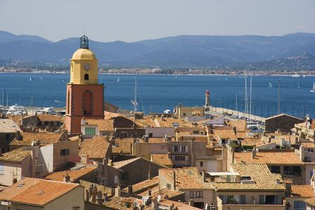 sea seaport: panorama of saint-tropez - in the past a smalll fishing village, but today a meeting place of celebrities on the french riviera, mediterranean sea Stock Photo