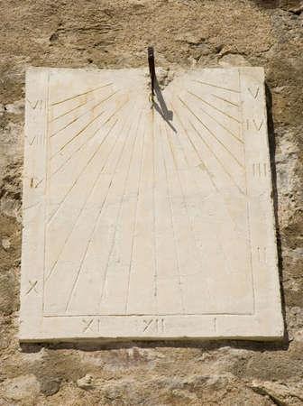 ancient wall sundial - citadel of saint-tropez, france  photo