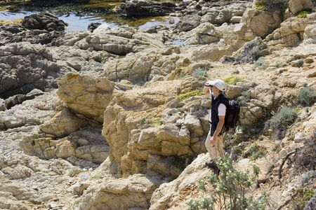 scientist on the rocks - french riviera, mediterranean sea  Stock Photo - 1885480