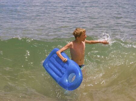 boy having fun in the ocean photo
