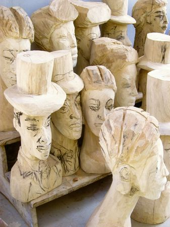 busts: unfinished wooden busts