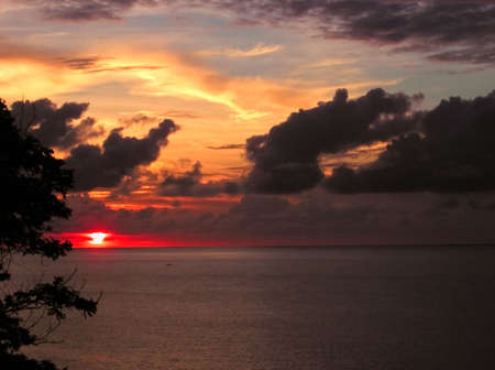 sunset over the ocean - tobago, west indies photo