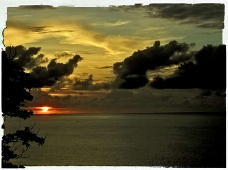 indies: old polaroid photo of a sunset over the ocean - tobago, west indies Stock Photo