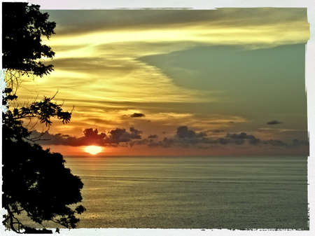 sunup: old polaroid photo of a sunset over the caribbean sea - tobago, west indies