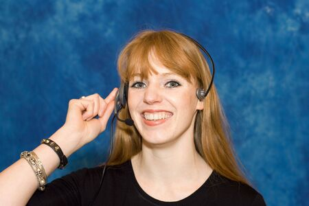 Young businesswoman wearing headset Stock Photo - 3140373