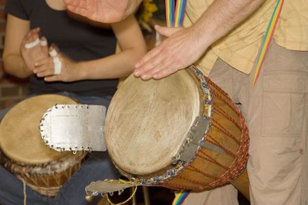 two men playing djembe - african drum