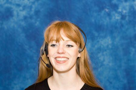 operative: Female telecommunications operative - smiling