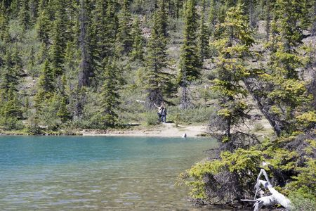 bow lake with young hikers - canadian rockies, banff national park photo