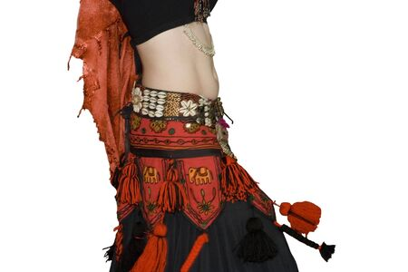 Young women belly dancing - performance in a traditional outfit